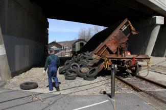 Bob Eberheim, a volunteer and board member with the RMNE, supervises the dumping of tires removed from the Frost Bridge area in Thomaston and Watertown before they were to be recycled.